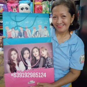 korean idol images on a gift bag